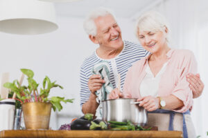 image of a senior couple cooking