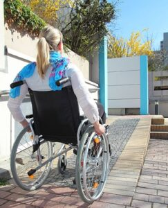 image of woman in wheelchair using ramp