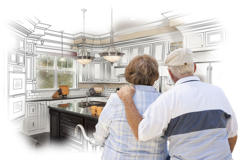 image of senior couple looking over custom kitchen design